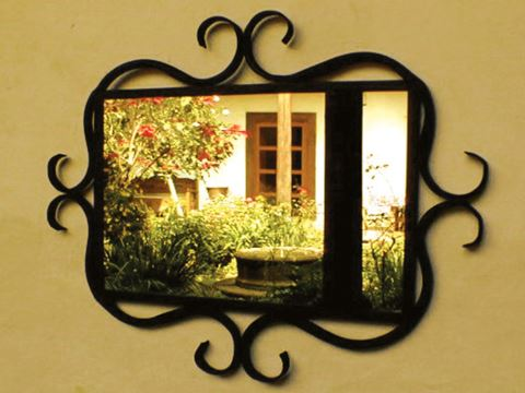Wrought Iron Mirror Frame with Curved Details
