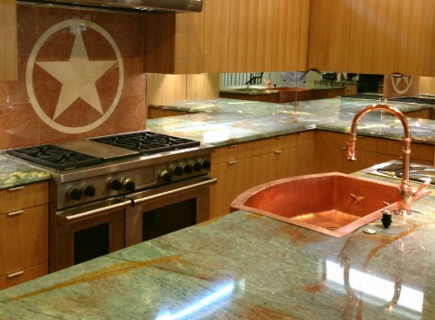 rounded front copper farmhouse sink with stars